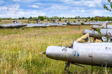 Old czechoslovakian Aero L-29 Delfin (Maya) military jet trainer aircrafts on an abandoned airfield in Ukraine