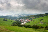 Fotografie Summertime rural landscape - view at the village Pribis, district Dolny Kubin, Slovakia