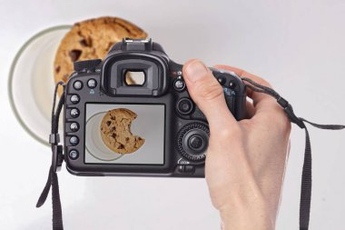Food photographer taking still life pictures
