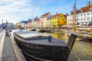 Copenhagen, Denmark - May 1, 2017: Nyhavn is a 17th-century waterfront, canal and entertainment district in Copenhagen, Denmark. stock vector