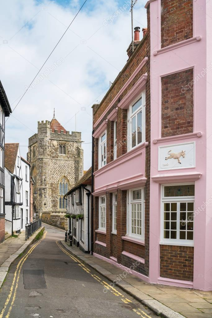 View of a St Clement churchl down a street in Hastings, UK