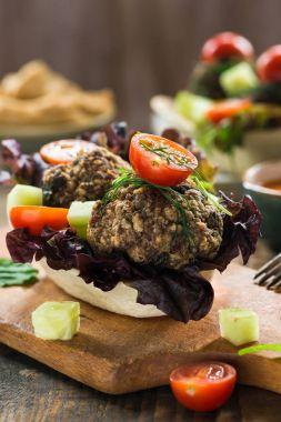 Mediterranean beef meatballs with salad in taco shells