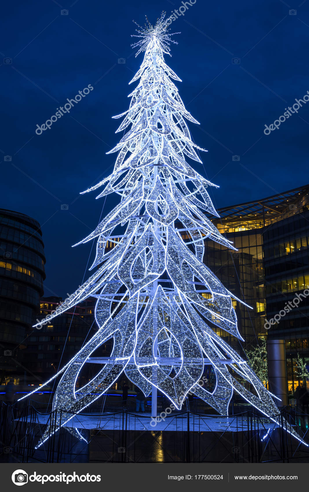 View Of A Modern Led Christmas Tree Standing Next To The City H