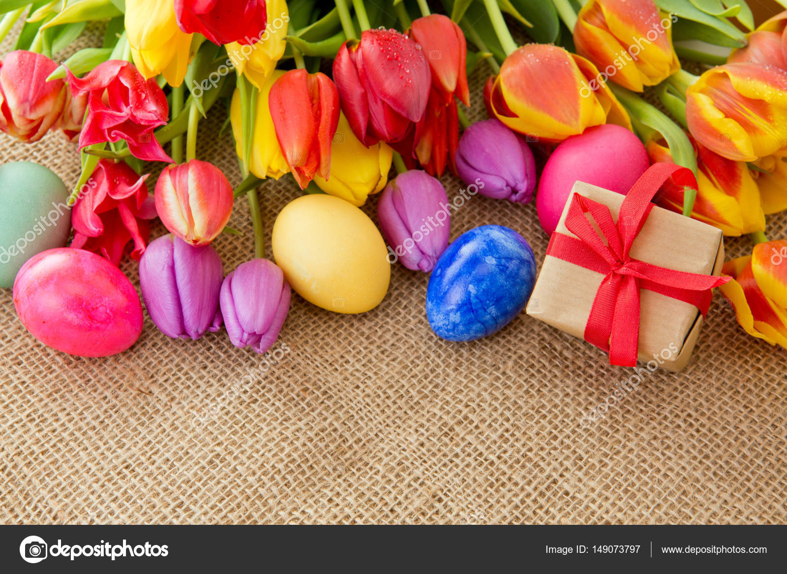 Spring tulips with colorful easter eggs and gift box stock spring tulips with colorful easter eggs and gift box stock photo negle Choice Image