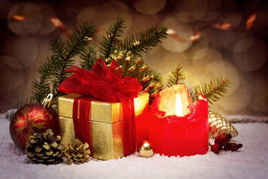 Advent candle and golden gift.