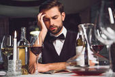 Man looking at wine with lost sight