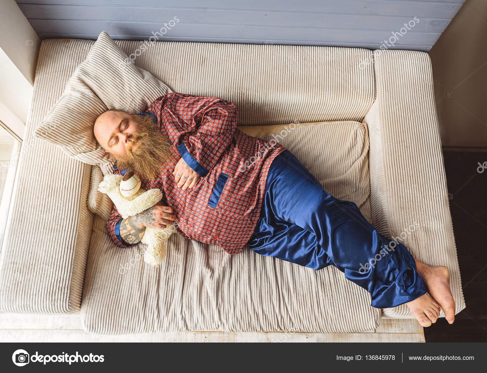 Sleepy thick guy lying on couch — Stock Photo © iakovenko123 ...