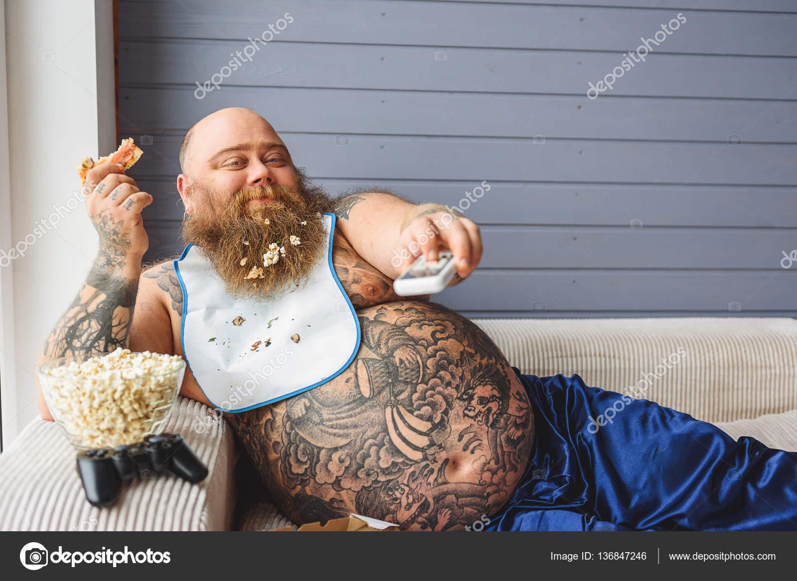 Lazy thick guy watching tv at home — Stock Photo © iakovenko123 ...