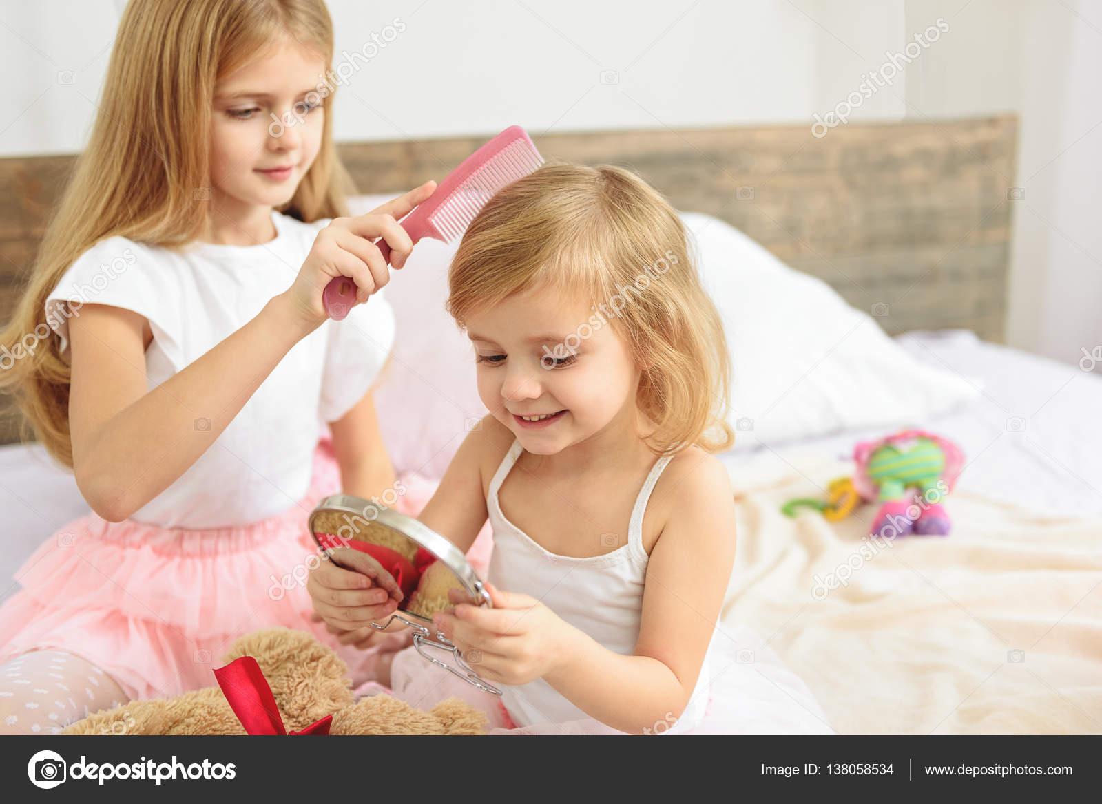 Happy Sister Combing Childish Hair Stock Photo Iakovenko123