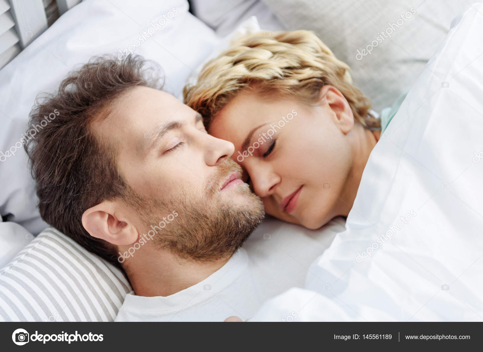 Happy husband and wife napping at home — Stock Photo