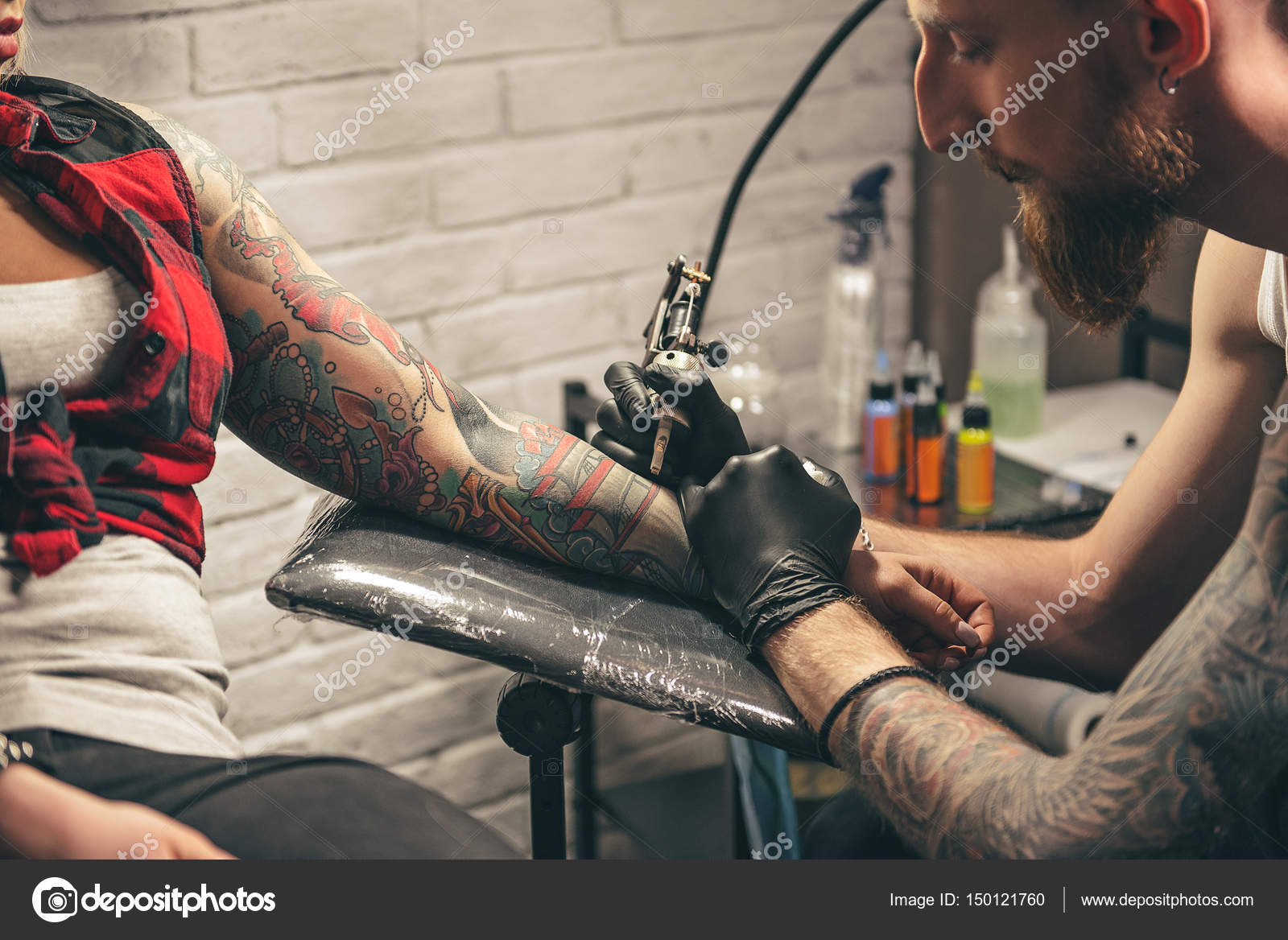 depositphotos_150121760-stock-photo-calm-man-making-tattoo-on.jpg