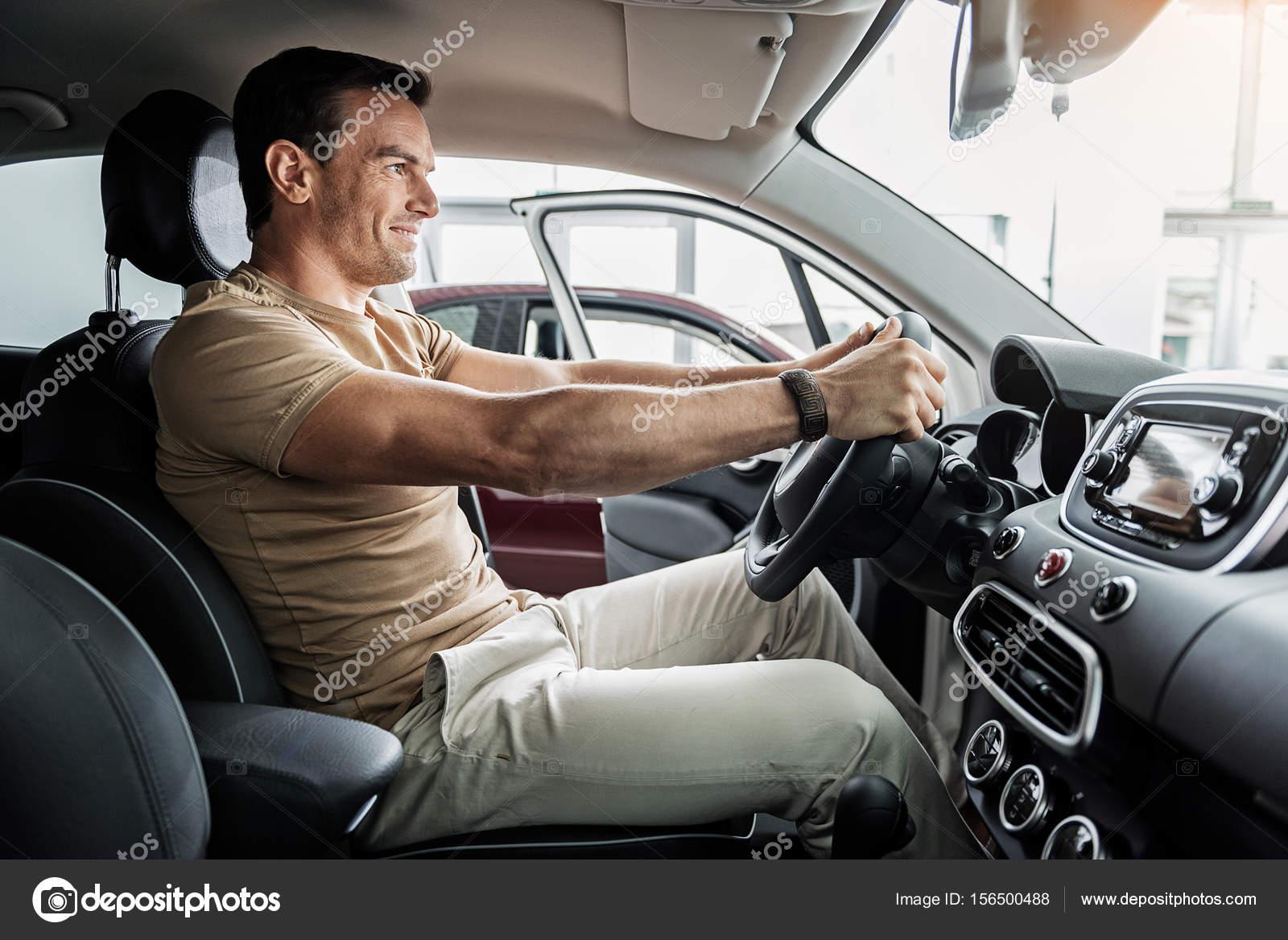 Happy man examining modern automobile — Stock Photo © iakovenko123 ...