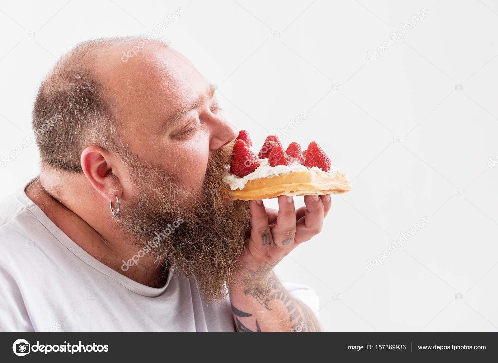 Entspannte Mannlichen Fatso Lecker Kuchen Essen Stockfoto