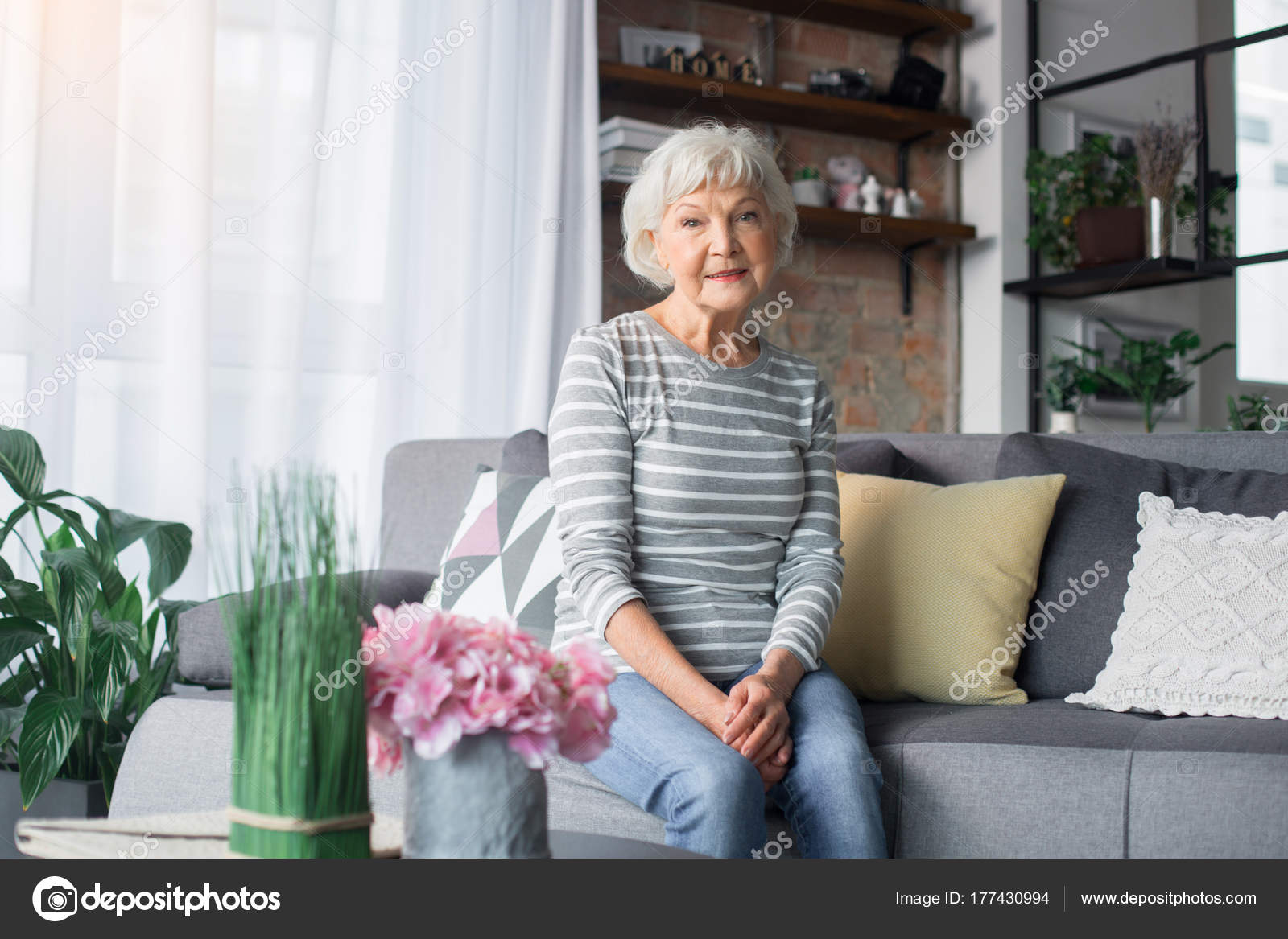 Old Lady Floral Couch Pretty Old Lady Sitting On Sofa At Living