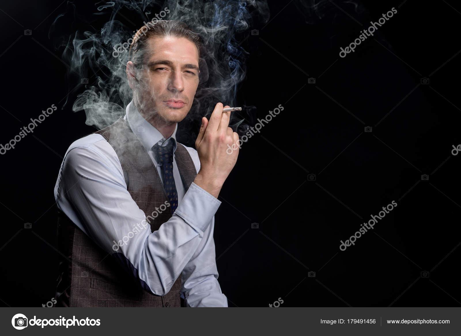 Elegant Businessman Is Enjoying Unhealthy Habit Stock Photo