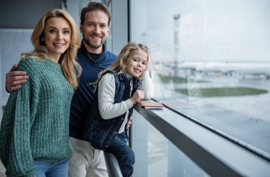 Happy family expecting for the flight