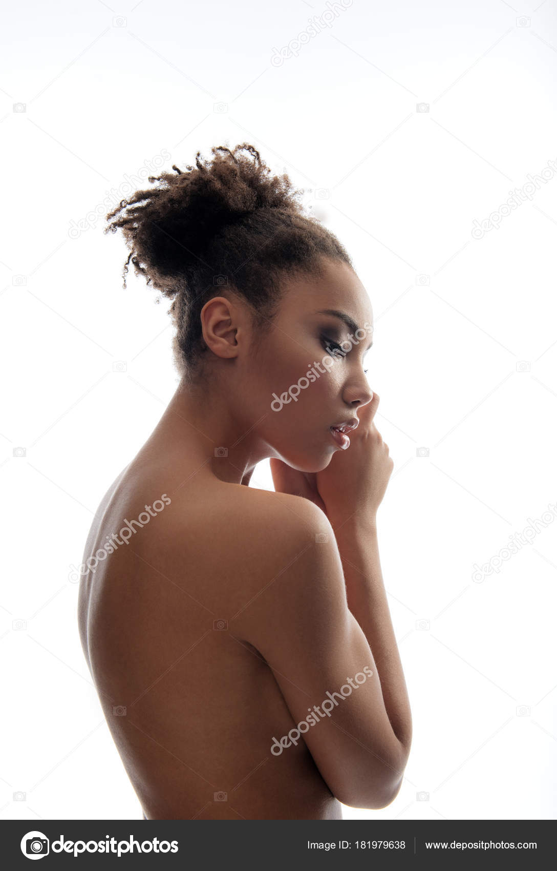 Woman poses nude side profile