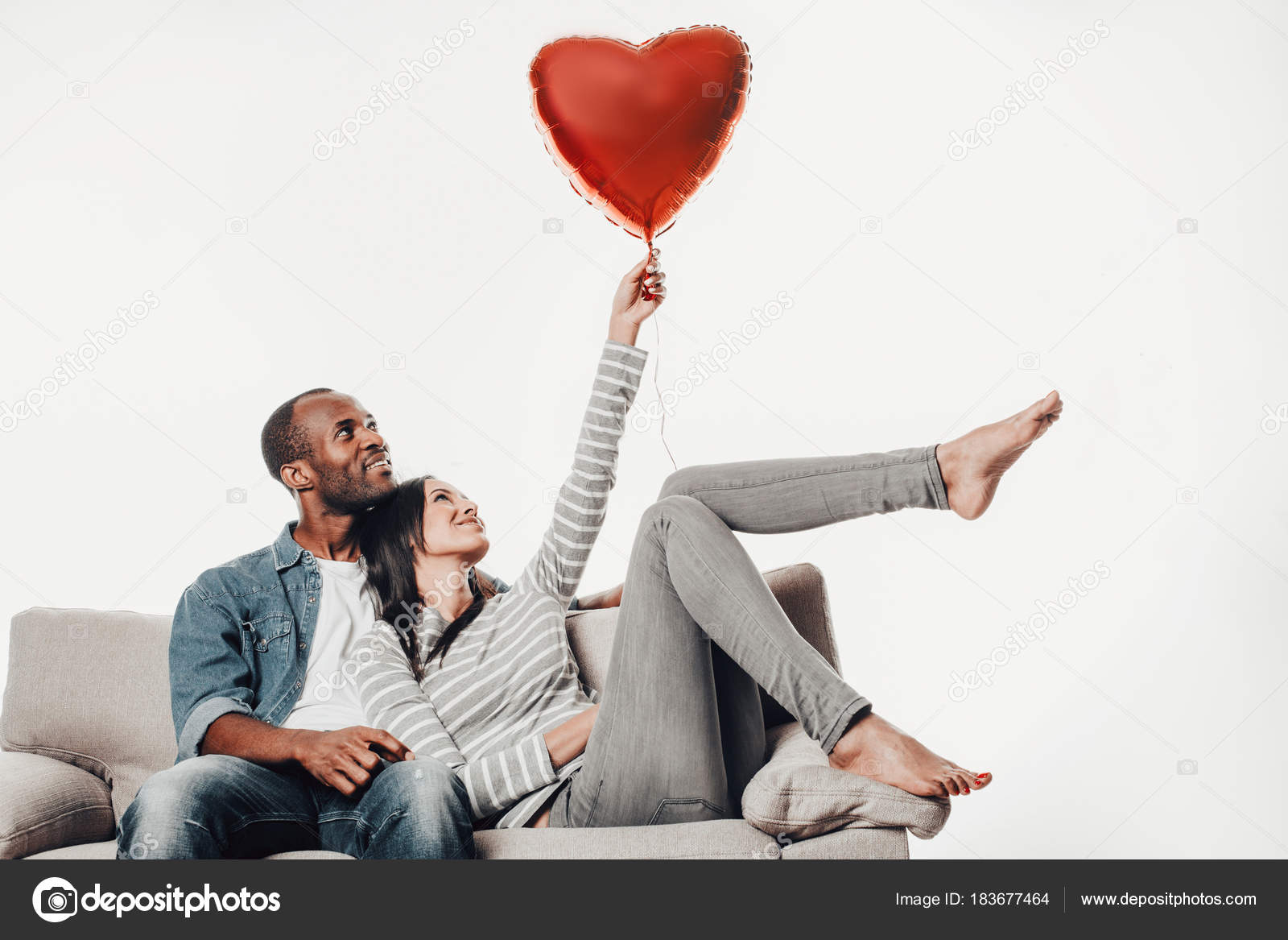 Satisfied Couple In Love Holding Up Balloon Stock Photo