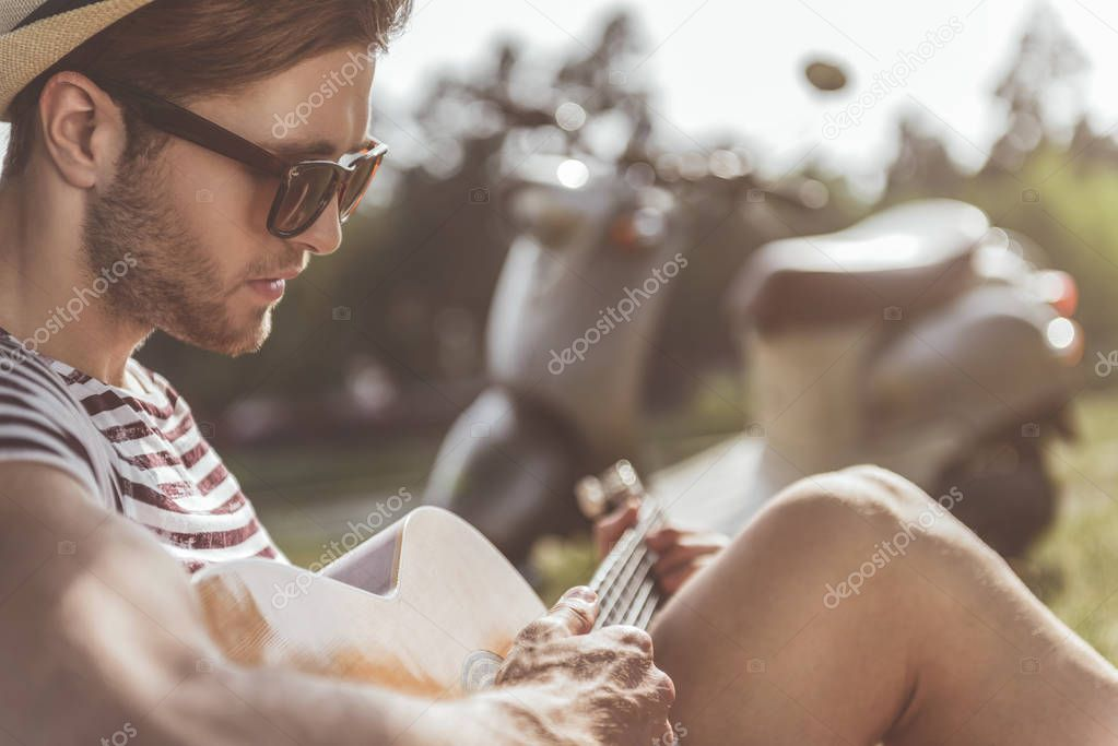 Romantic guy composing melody with calmness