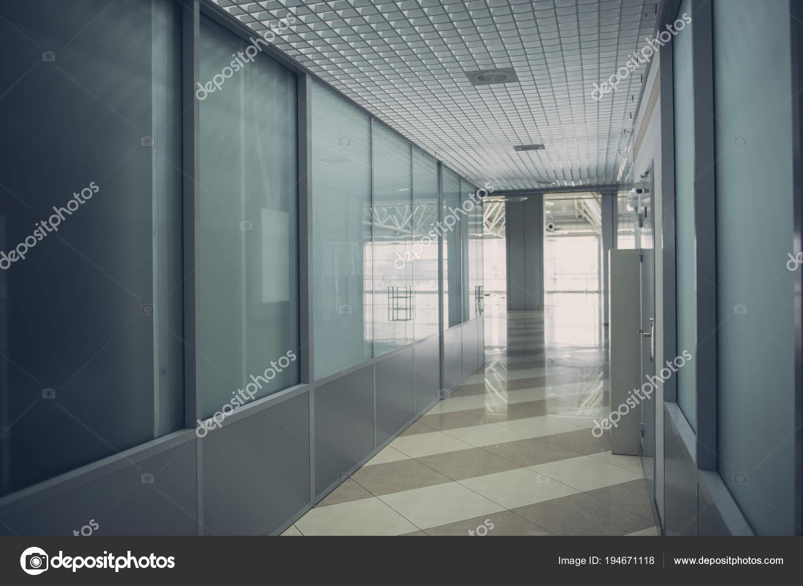 Lange gang met glazen wanden u2014 stockfoto © iakovenko123 #194671118