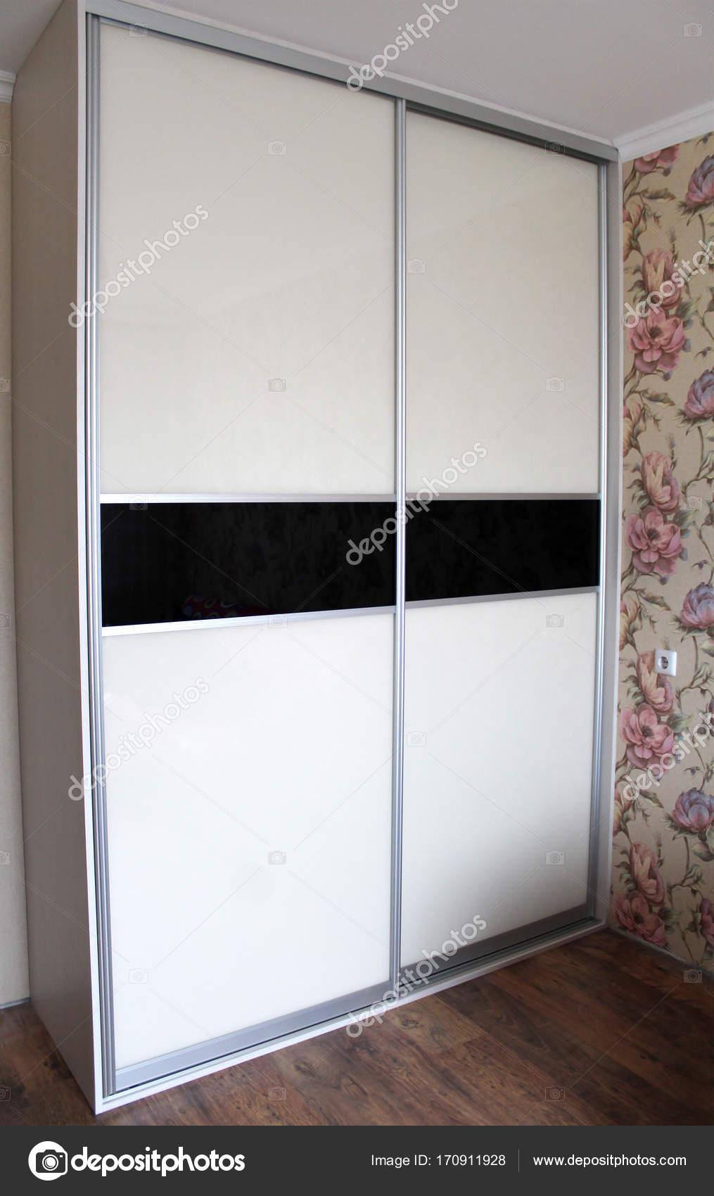 https://st3.depositphotos.com/4233899/17091/i/1600/depositphotos_170911928-stock-photo-wardrobe-with-sliding-doors-furniture.jpg