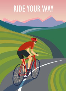 Cyclist  riding near the hills and mountains