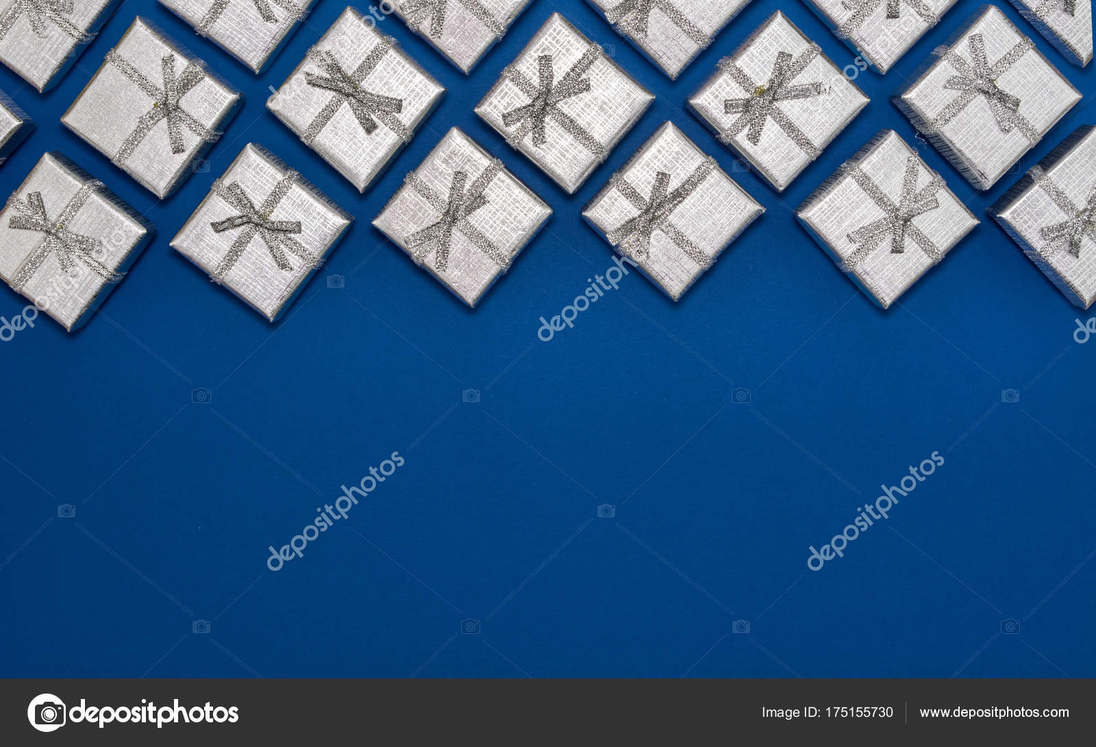 border of silver shiny gifts on blue background new years and christmas decorations stock
