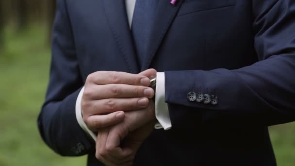 Man in classical suit look at wrist watch