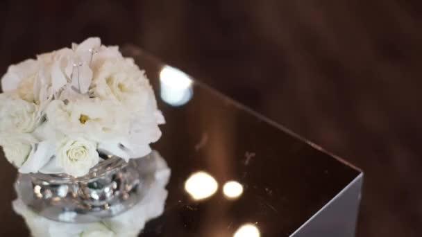 Pair of wedding rings on white flowers pillow