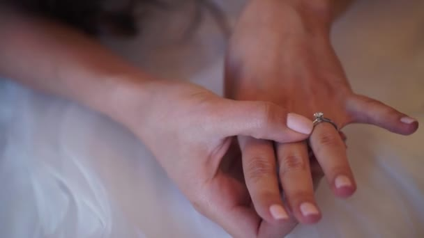 Engagement ring on brides hand