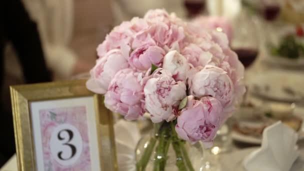 Bouquet with peonies on a table