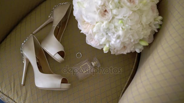 Womans shoes on heels, bouquet and perfume