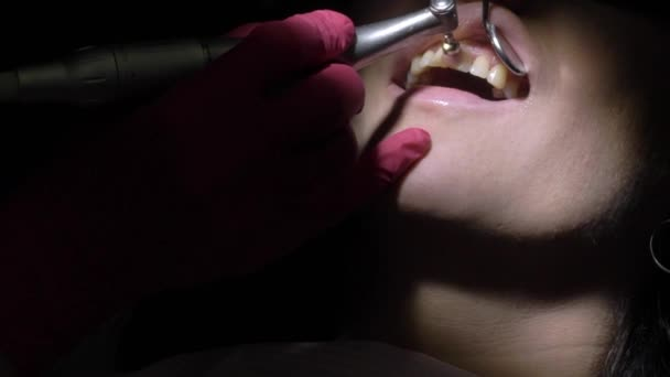 Dentist making tooth cleaning for patient