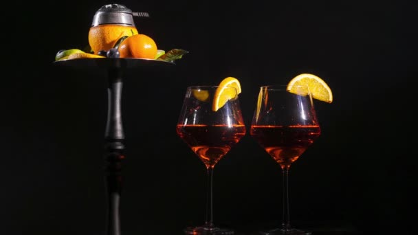 Pair of glasses with alcoholic drink beverage wine and hookah with fruits