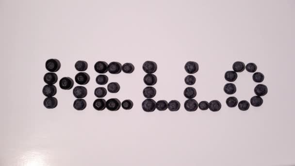 Hello sign word letters writing from blueberries