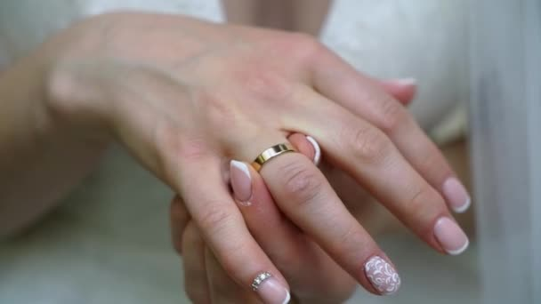Young woman put on her finger jewelry ring with diamond. Luxury expensive proposal ring. Bride in wedding day
