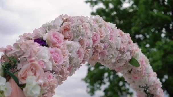 Wedding ceremony decorated with flowers. Marriage reception with bouquets. Beautiful party.