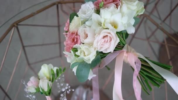 Bouquet of flowers of white and pink roses. Wedding bouquet of the bride. Morning preparations of the newlyweds. Floral arrangement