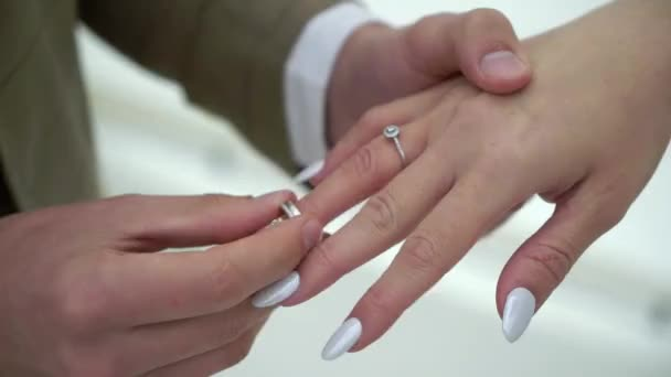 Bride and groom exchange wedding rings at ceremony. Lovely couple