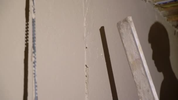 Plastering mortar machine. Automatic plaster. Repairing or renovating house or apartment. Builder at construction
