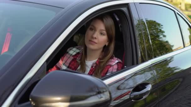 Young woman car driver in traffic jam, nervous girl in automobile.