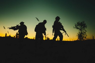 Silhouette of military soldiers with weapons at night. shot, holding gun, colorful sky. military concept. stock vector