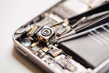 Repairing Damaged Smart Phone in service center. closeup