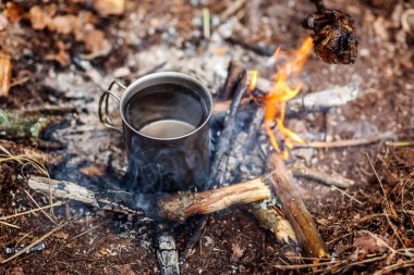 metal mug . bushcraft, adventure, travel, tourism and camping co