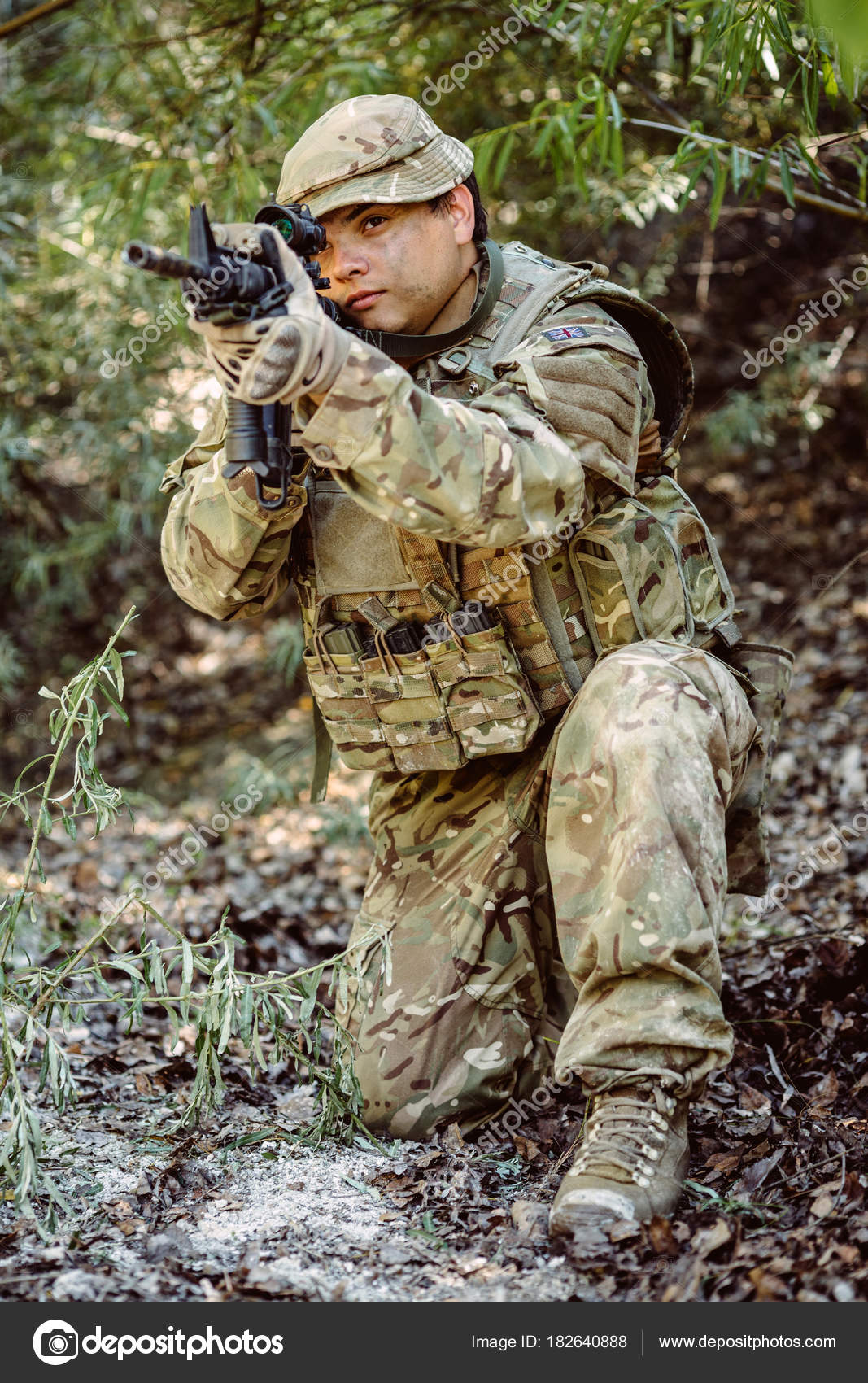 British Army sniper during the military operation in the mountain. war, army,  technology and people concept. — Photo by kaninstudio