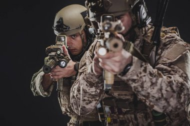 Special forces United States soldiers or private military contractors holding rifle. Image on a black background. war, army, weapon, technology and people concept