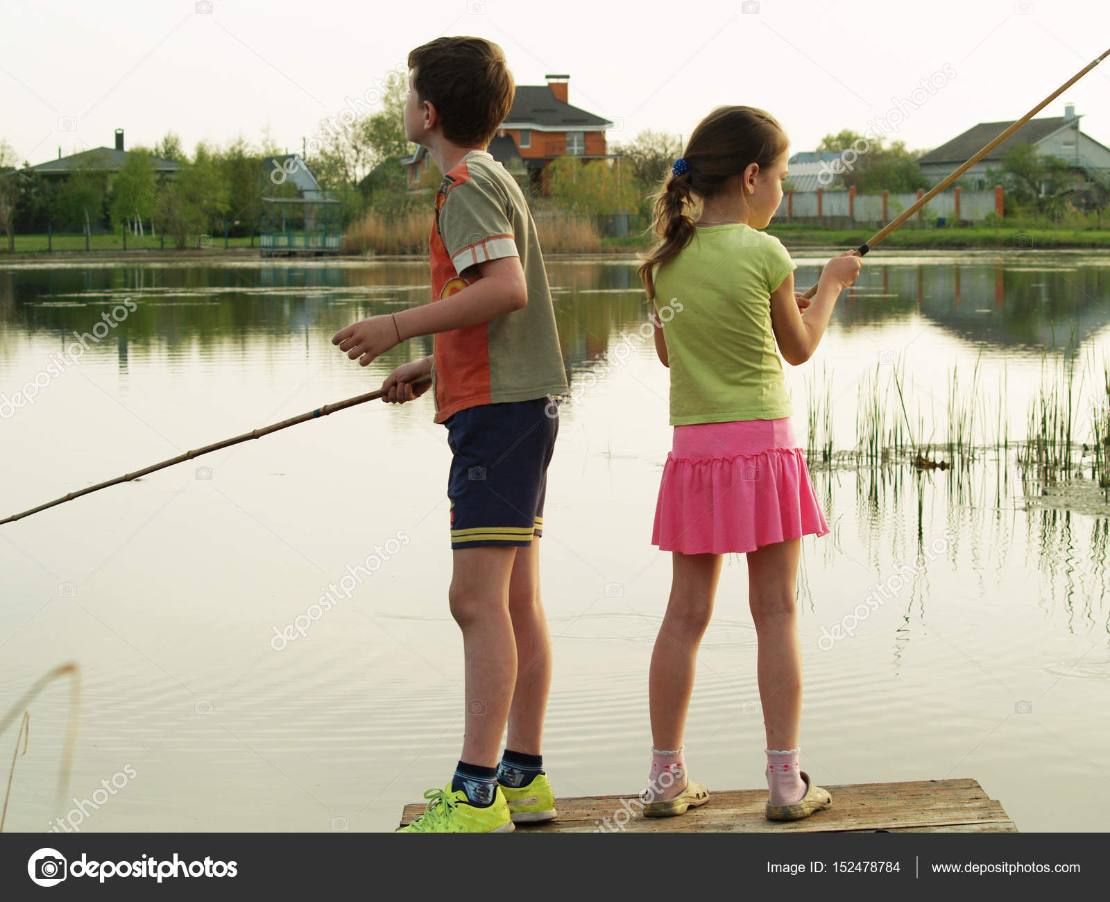 Children fishing on the river stock photo maxim1717 for Do kids need a fishing license