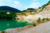 Beautiful landscape, lake in quarry with mountain in background