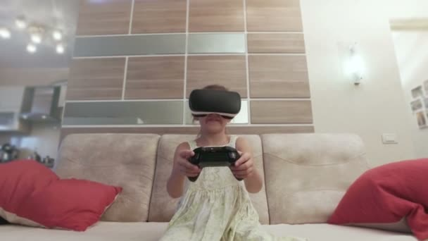 Girl with virtual reality helmet are playing computer console game