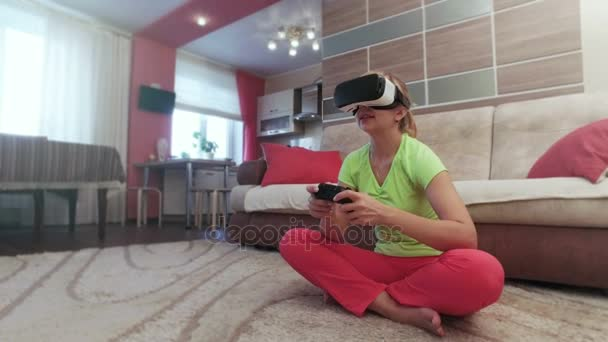 Beautiful woman with virtual reality helmet are playing computer console game